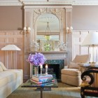Refined modern furniture and neutral colors creates a comfortable living room in one of New York's most celebrated Italian Renaissance Revival buildings