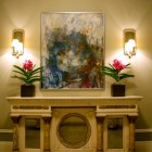 Buffet table frames a display area for artwork, Thomas Burak Interiors, NYC